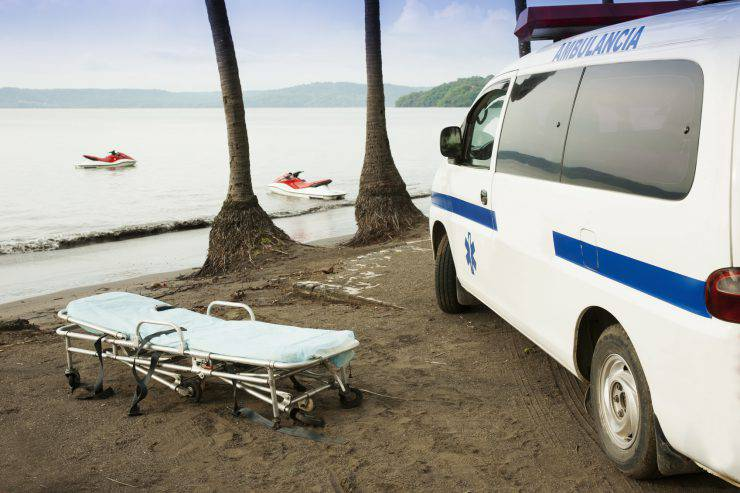 A photograph of an ambulance on a beach in Latin America.Please Browse: