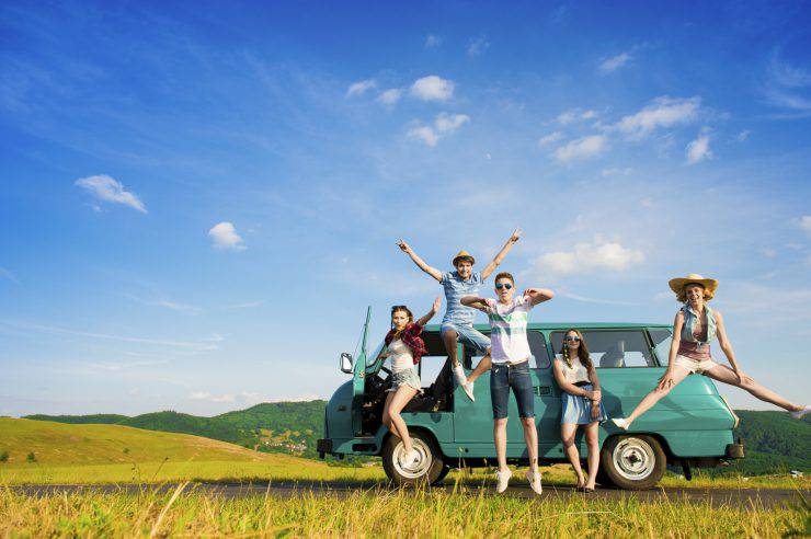 Young hipster friends on road trip on a summers day