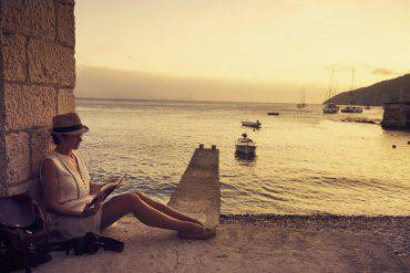 Shot of a young woman reading a book while out travelinghttp://195.154.178.81/DATA/i_collage/pu/shoots/805799.jpg