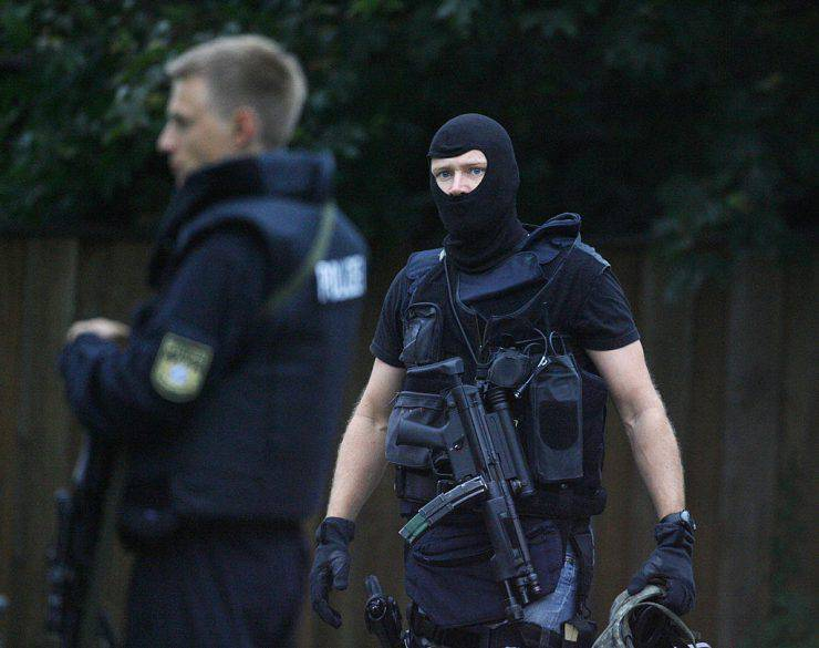 Policemen stand near the Carolinum secondary school in Ansbach, southern Germany on September 17, 2009. A 18-year-old man went on a rampage in his school, lobbing Molotov cocktails and injuring 10 people, three seriously, before being shot and arrested by police, authorities said. AFP PHOTO DDP /TIMM SCHAMBERGER GERMANY OUT (Photo credit should read TIMM SCHAMBERGER/AFP/Getty Images)