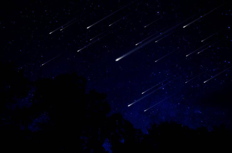 Meteor shower in night sky illustration