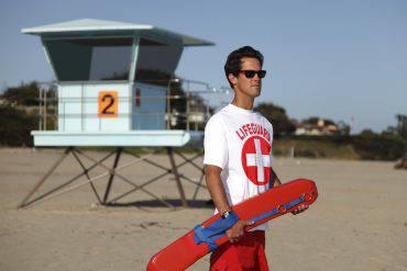 Male lifeguard at the ocean beach.