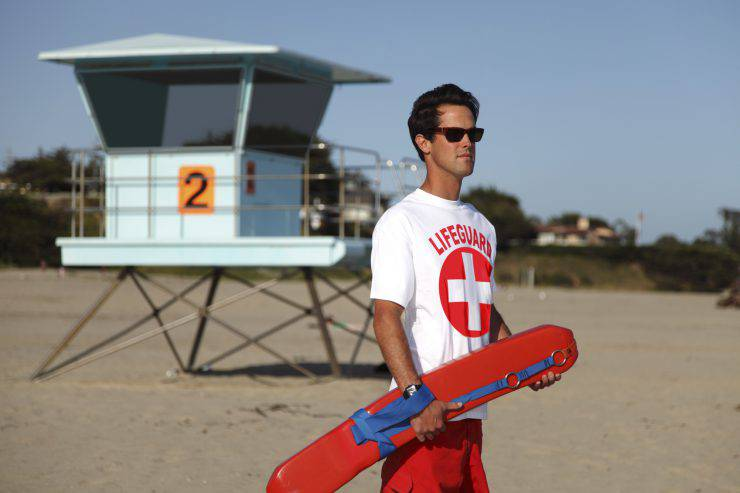 Male lifeguard at the ocean beach.