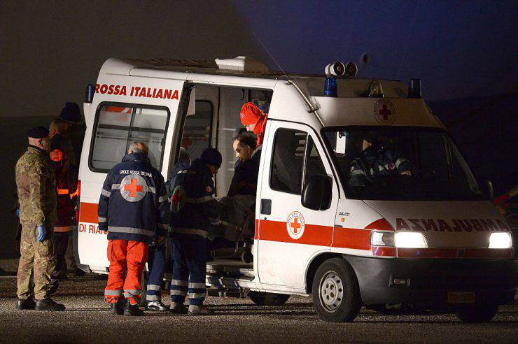 A rescued passenger of the Norman Atlantic ferry, is taken in an ambulance as he arrives in Brindisi southern Italy with the italian Navy San Giorgio on December 30, 2014. Eleven passengers dead, dozens unaccounted for and no-one able to say with any certainty how many people were on board the Norman Atlantic when it burst into flames. A Greek ferry tragedy in the Adriatic turned into a murder mystery on December 30 as a fiasco over the accuracy of the passenger list added to questions over safety systems aboard. AFP PHOTO / FILIPPO MONTEFORTE        (Photo credit should read FILIPPO MONTEFORTE/AFP/Getty Images)
