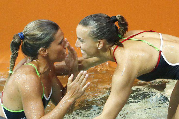 Italy's Tania Cagnotto and Italy's Francesca Dallape'congratulate each others during the Women's Synchronized 3m Springboard Final during the diving event at the Rio 2016 Olympic Games at the Maria Lenk Aquatics Stadium in Rio de Janeiro on August 7, 2016.   China's Wu Minxia and China's Shi Tingmao won the gold, Italy's Tania Cagnotto and Italy's Francesca Dallape' took the silver and Australia's Maddison Keeney and Australia's Anabelle Smith took the bronze.  / AFP / Odd Andersen        (Photo credit should read ODD ANDERSEN/AFP/Getty Images)