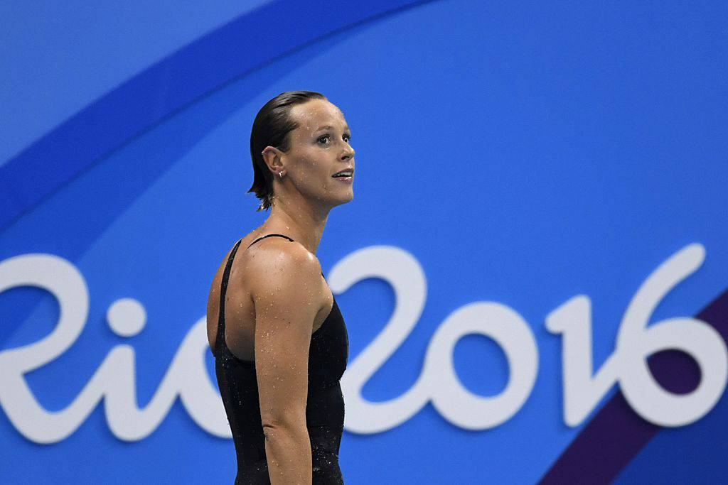 Italy's Federica Pellegrini looks at the results board after competing in the Women's 200m Freestyle semifinal during the swimming event at the Rio 2016 Olympic Games at the Olympic Aquatics Stadium in Rio de Janeiro on August 8, 2016.   / AFP / CHRISTOPHE SIMON        (Photo credit should read CHRISTOPHE SIMON/AFP/Getty Images)