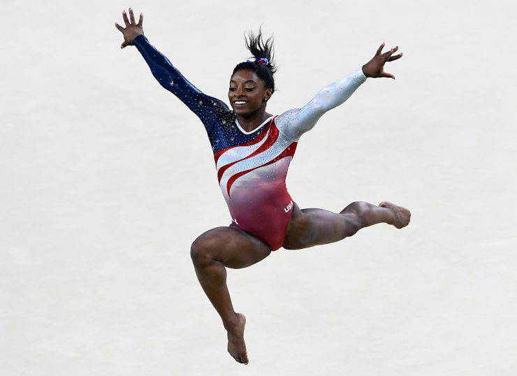 RIO DE JANEIRO, BRAZIL - AUGUST 09:  Simone Biles of the United States competes on the floor during the Artistic Gymnastics Women's Team Final on Day 4 of the Rio 2016 Olympic Games at the Rio Olympic Arena on August 9, 2016 in Rio de Janeiro, Brazil.  (Photo by Quinn Rooney/Getty Images)