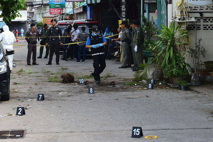 Investigation officials collect evidence from the crime scene after a small bomb exploded in Hua Hin on August 12, 2016. A string of bomb attacks targeting Thailand's crucial tourism industry have killed four people, officials said on August 12, sending authorities scrambling to identify a motive and find the perpetrators. / AFP / MUNIR UZ ZAMAN (Photo credit should read MUNIR UZ ZAMAN/AFP/Getty Images)