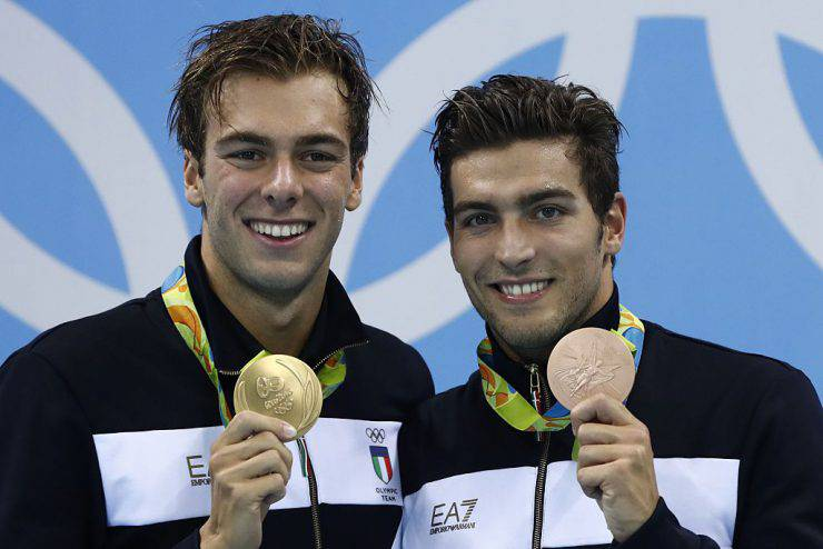 Italy's gold medallist Gregorio Paltrinieri and Italy's bronze Gabriele Detti (R) pose on the podium after the Men's swimming 1500m Freestyle Final at the Rio 2016 Olympic Games at the Olympic Aquatics Stadium in Rio de Janeiro on August 13, 2016.   / AFP / Odd ANDERSEN        (Photo credit should read ODD ANDERSEN/AFP/Getty Images)