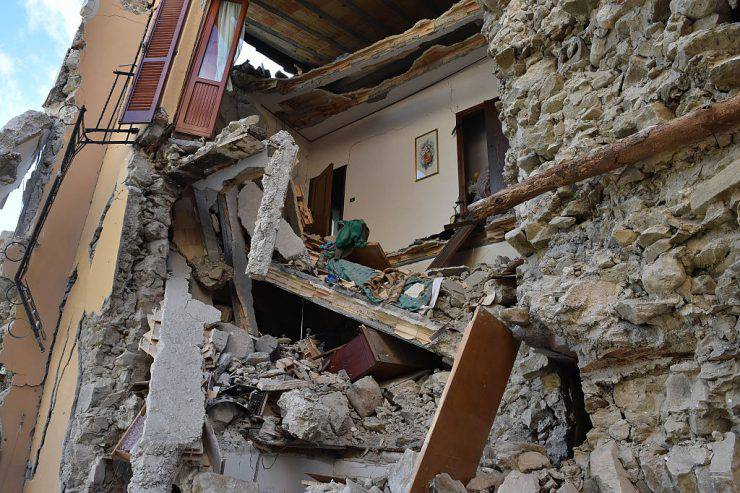 ARQUATA DEL TRONTO, ITALY - AUGUST 24:  A view of buildings damaged by the earthquake on August 24, 2016 in Arquata del Tronto, Italy. Central Italy was struck by a powerful, 6.2-magnitude earthquake in the early hours, which has killed at least thirteen people and devastated dozens of mountain villages. Numerous buildings have collapsed in communities close to the epicenter of the quake near the town of Norcia in the region of Umbria, witnesses have told Italian media, with an increase in the death toll highly likely  (Photo by Giuseppe Bellini/Getty Images)