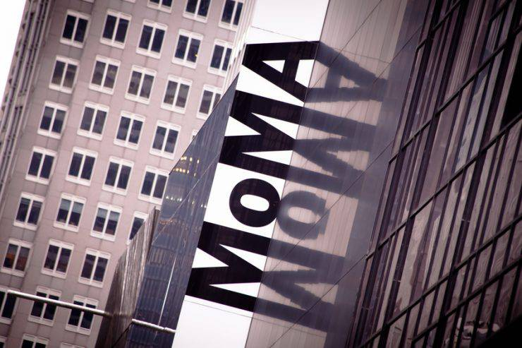 """New York, USA - Oct 1, 2011: Upward view of the exterior of the Museum of Modern Art in Manhattan, New York City. MoMA on the building's facial is an acronym of the name of the art gallery."""