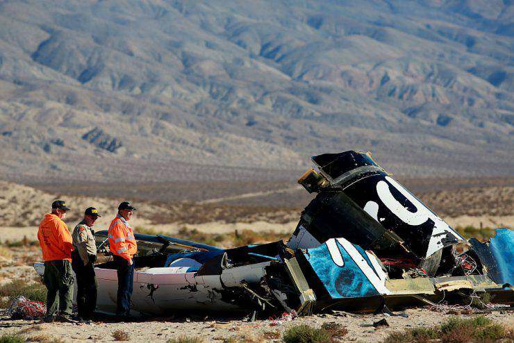 MOJAVE, CA - NOVEMBER 2 : Sheriff's deputies inspect the wreckage of the Virgin Galactic SpaceShip 2 in a desert field November 2, 2014 north of Mojave, California on The Virgin Galactic SpaceShip 2 crashed on October 31, 2014 during a test flight, killing one pilot and seriously injuring another. (Photo by Sandy Huffaker/Getty Images)