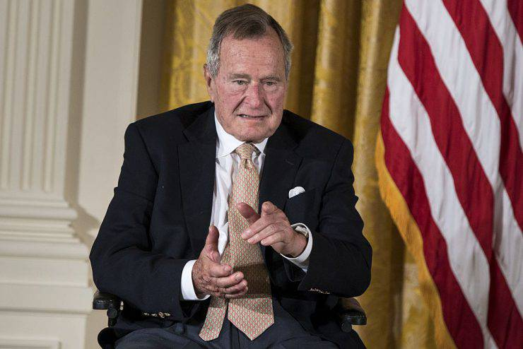 Former US President George H. W. Bush points to his wife Barbara Bush during an event in the East Room of the White House July 15, 2013 in Washington, DC. Obama hosted former US President George H. W. Bush and Barbara Bush to honor the 5000th Daily Point of Light Award which is a program started in response to Bush's call for volunteerism. AFP PHOTO/Brendan SMIALOWSKI        (Photo credit should read BRENDAN SMIALOWSKI/AFP/Getty Images)