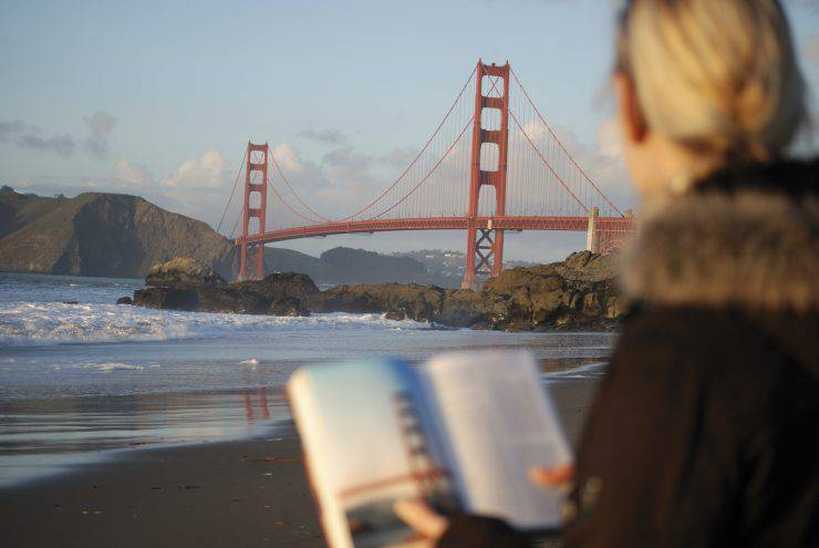 With help of the tourist guide this tourist found the Golden Gate Bridge.