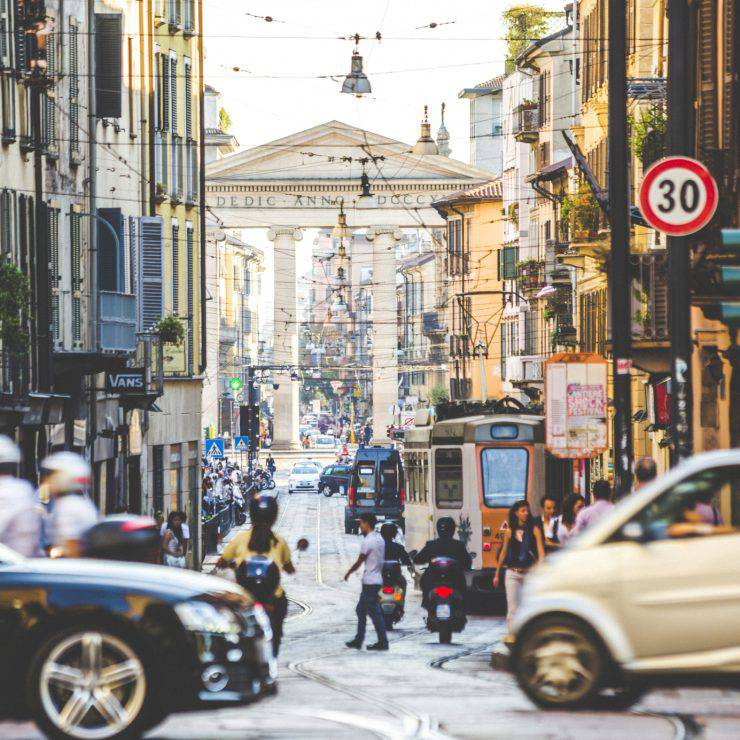 Evening time in busy streets of Milan, Italy.