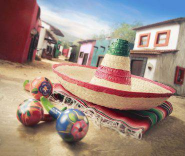 "Mexican hat ""sombrero"" on a ""serape"" in a mexican town"