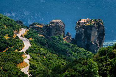The curve road to Holy Trinity Monastery. Panoramic view of landscape of Meteora, Greece