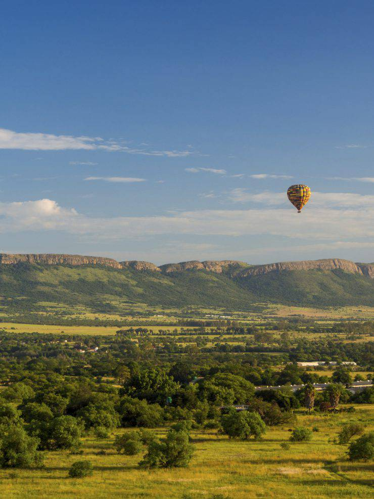 Hot Air Balloon in front of Magaliesberg Mountains, South Africa