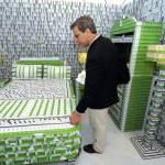 A tourist checks out a bedroom made of k