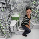 A woman poses sitting on a toilet made o