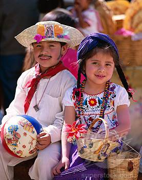 Portrait of a girl and boy dressed in traditional costumes, Oaxaca, Mexico