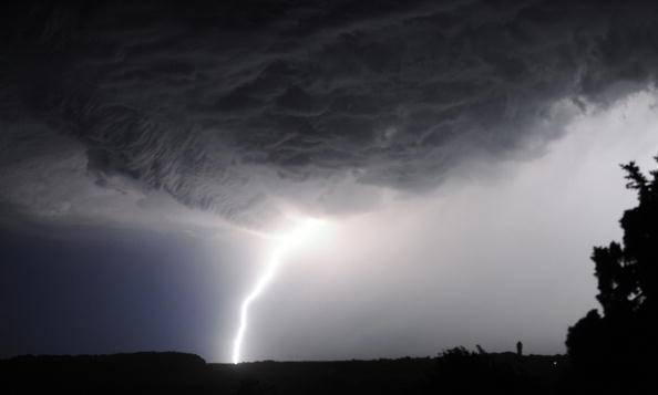 A thunderbolt lights up the sky above Ch